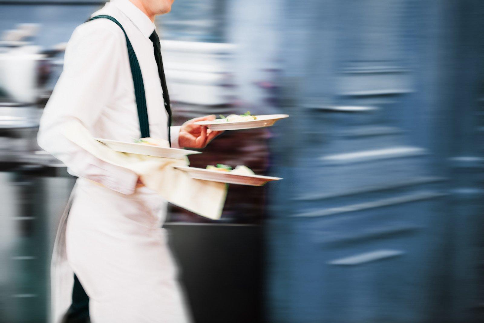 Restaurant employee running food
