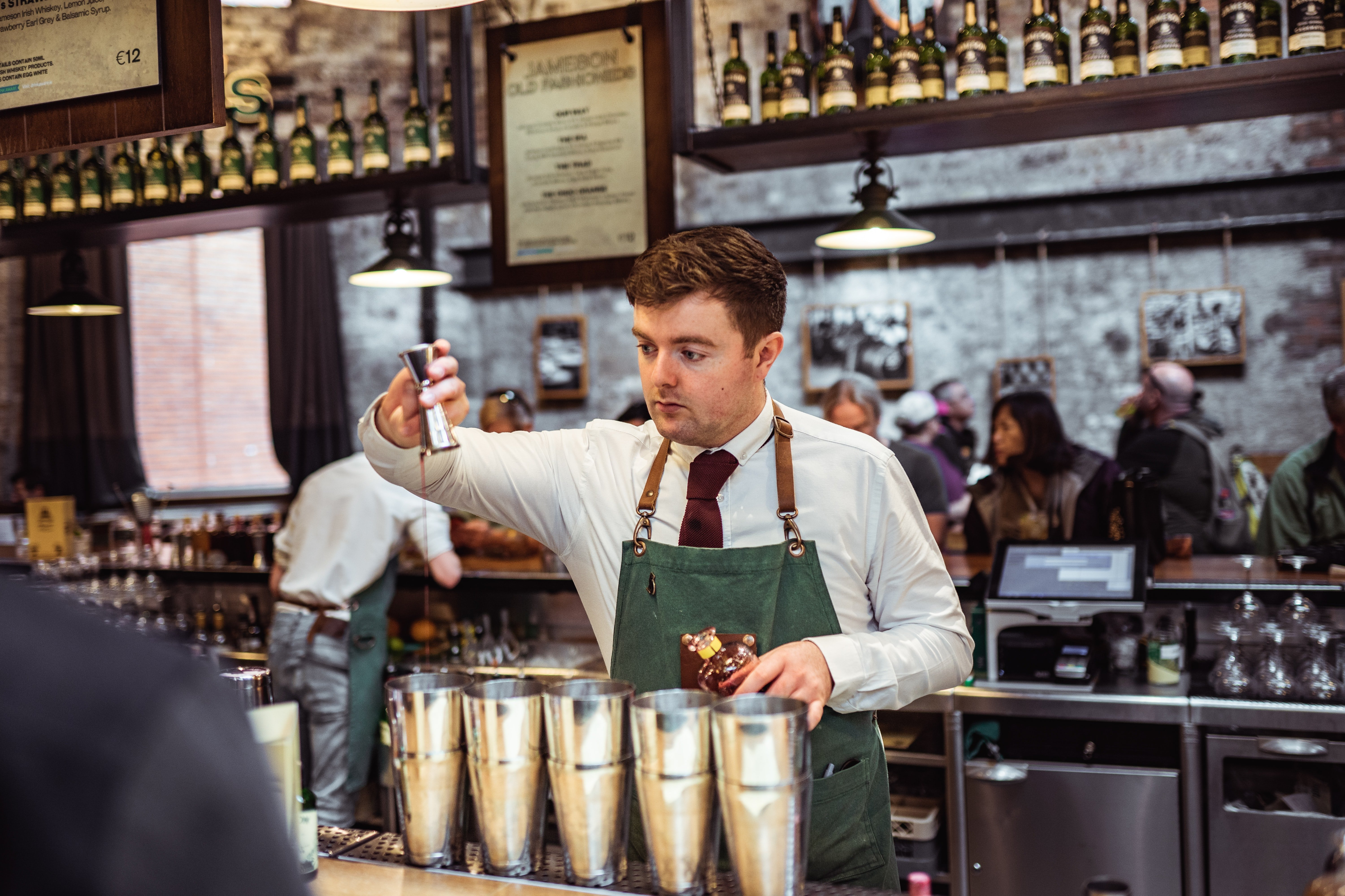 bartender mixing many drinks