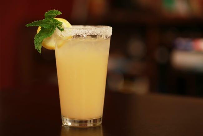 A cocktail with a salt rim glass.
