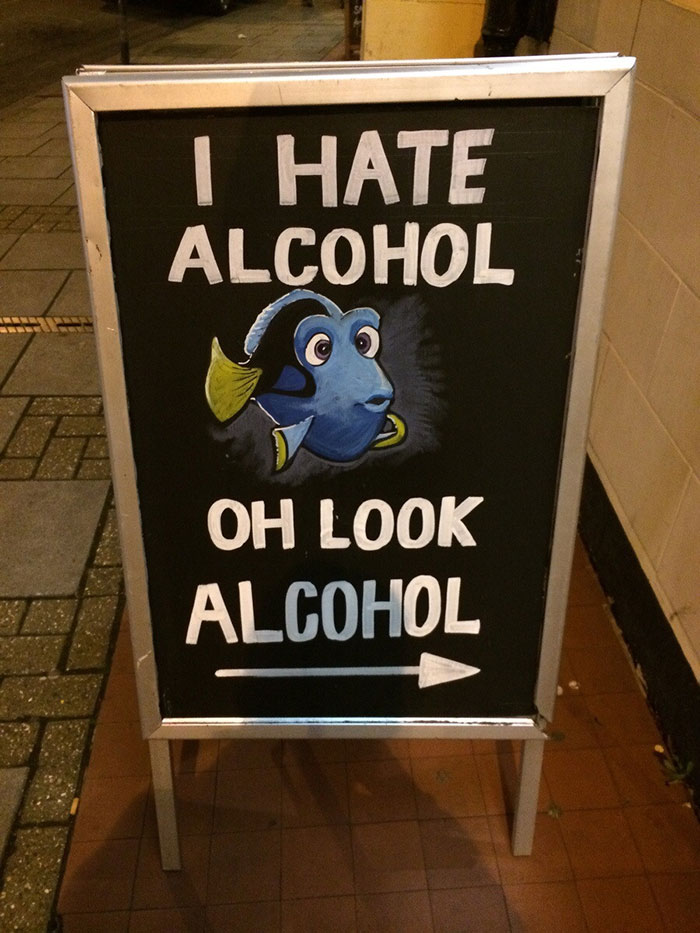 """A picture of the forgetful fish Dory from Pixar's Finding Nemo that reads """"I hate alcohol. Oh look, alcohol"""""""