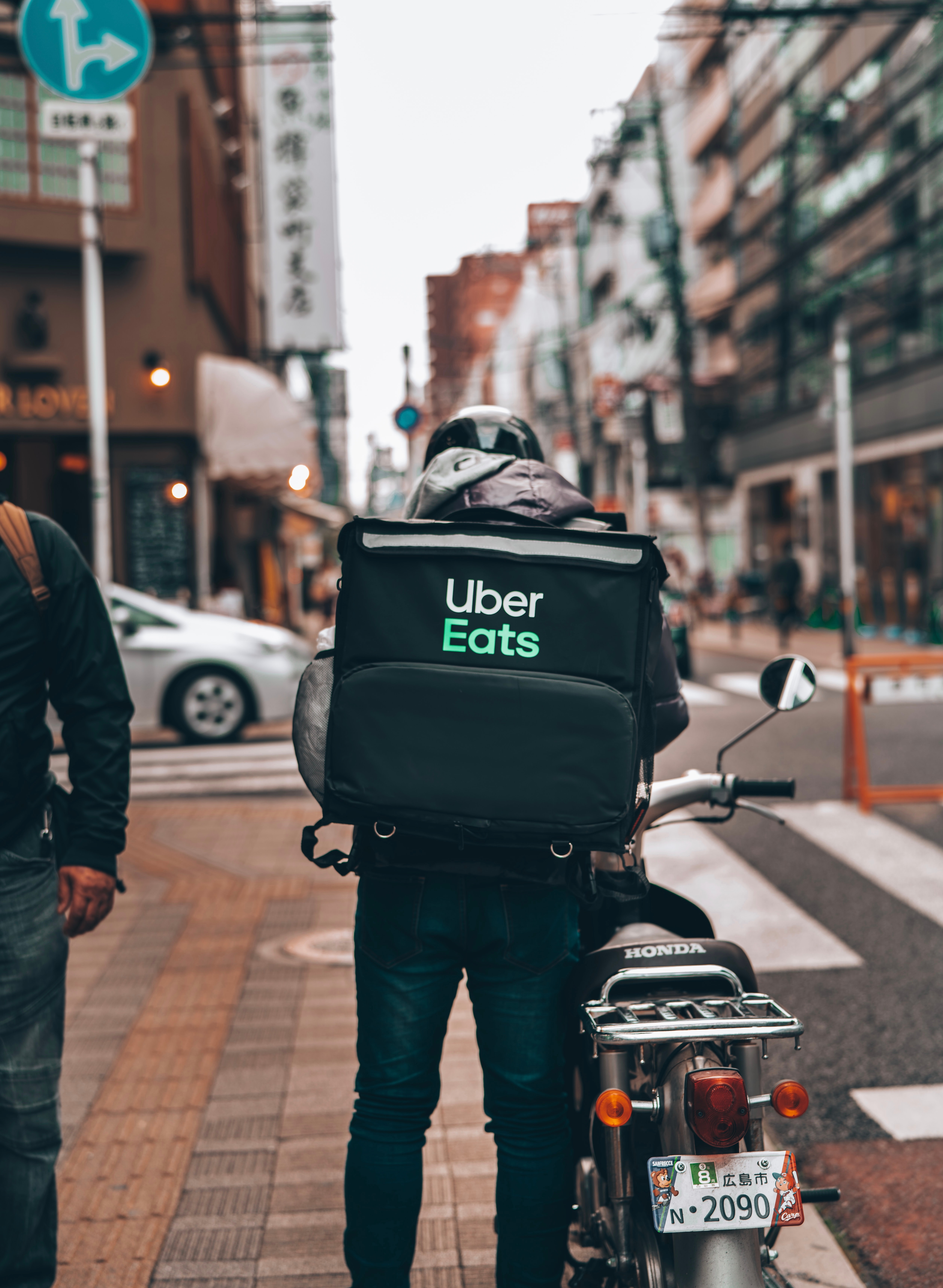 Image of a bicycle Uber Eats delivery person on a busy street